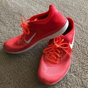 Coral/orange Nike running sneakers